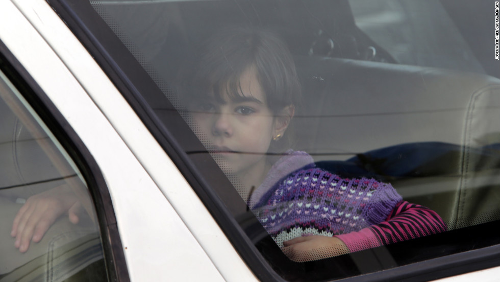 "A child sits in the back of a vehicle at the border crossing leading to Masnaa, Lebanon, as people wait to stamp their documents before leaving Syria on December 19. Click through to view images from Syria from December, or <a href=""http://www.cnn.com/2012/12/04/middleeast/gallery/syria-unrest-november/index.html"" target=""_blank"">see photos of the conflict from November.</a>"