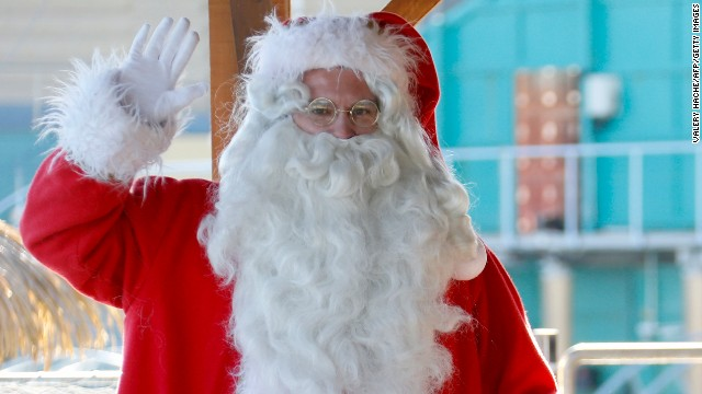 A man dressed in a Santa Claus costume poses with a sea lion at the animal exhibition park Marineland, on December 19, 2012 in Antibes, southeastern France.  AFP PHOTO / VALERY HACHE        (Photo credit should read VALERY HACHE/AFP/Getty Images)