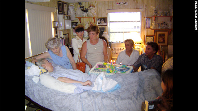 Family and friends celebrate Edwarda's 51st birthday.