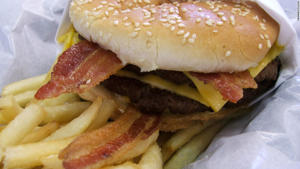 "<strong>Hardee's 2/3-lb Monster Thickburger:</strong> This two-patty monstrosity is a beef-lover's dietary downfall. With three slices of American cheese and four bacon strips, it has 1,300 calories, 93 grams of fat and 2,860 milligrams of sodium. That's without a soda or fries. <strong>Choose this instead: </strong>A Double Cheeseburger. It's beefy, cheesy, and has a fraction of the calories (410), fat (21 grams) and sodium (900 mg).<a href=""http://www.health.com/health/gallery/0,,20630037,00.html"" target=""_blank"">Health.com: The healthiest options at fast-food restaurants</a>"