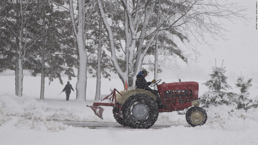 A man uses a tractor to clear snow in Waupun, Wisconsin, on December 20.