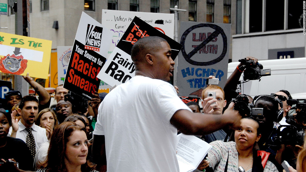 "One of the singles from the untitled album, ""Sly Fox,"" attacked Fox News for what Nas felt was scare tactics used by the network. Here, Nas attends a protest outside of Fox headquarters in 2008 in New York City."