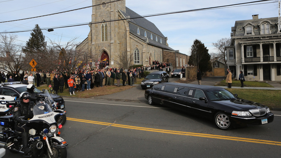 Family members depart the Trinity Episcopal Church in Newtown, Connecticut, following a funeral for Benjamin Wheeler, 6, on December 20.