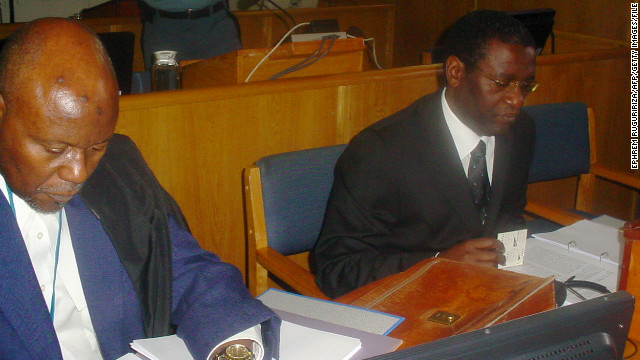 A 2008 photo shows ex-Rwandan planning minister Augustin Ngirabatware, right, with his then-lawyer Cecil John Maruma.