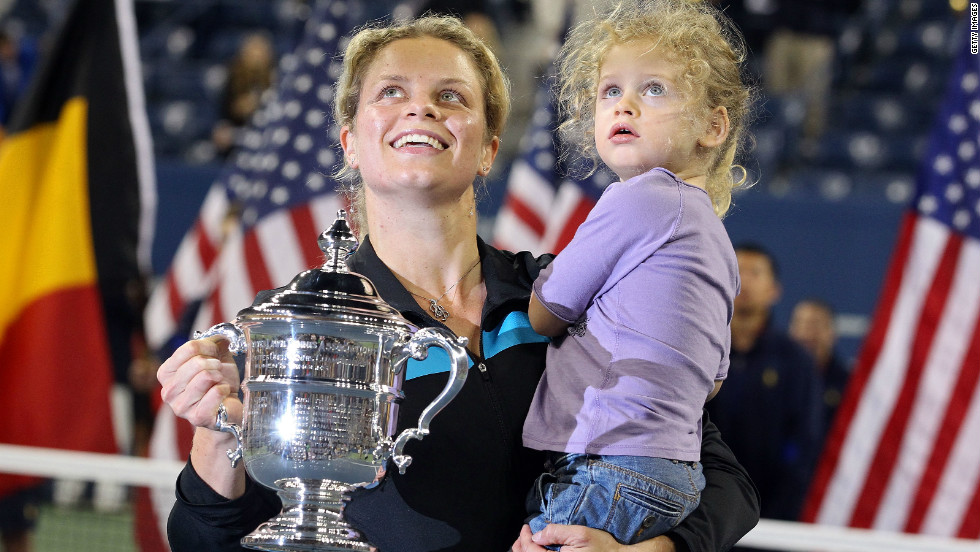 Kim Clijsters with daughter Jada and the 2010 U.S. Open trophy after beating Vera Zvonareva in the final.