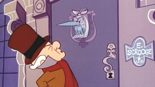 Scrooge sees a ghost.