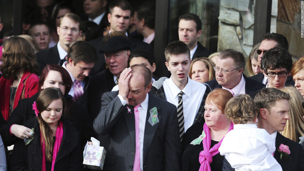 Mourners wipe tears away as they file out of the Church of Jesus Christ of Latter-day Saints after the funeral of Emilie Parker in Ogden, Utah, on Saturday, December 22.