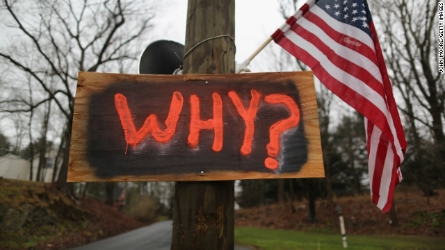 A sign near a cemetery of a victim in the school shooting in Newtown, Connecticut.