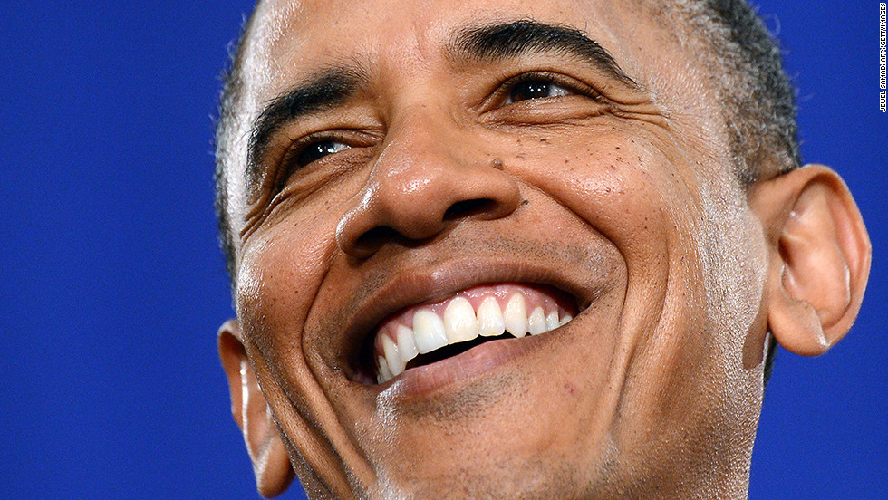 Obama smiles before speaking on the economy during a campaign event in Cleveland on June 14.
