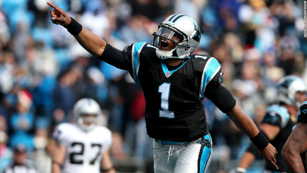 Cam Newton of the Carolina Panthers celebrates after throwing a touchdown pass to teammate Steve Smith against the Oakland Raiders at Bank of America Stadium on Sunday in Charlotte, North Carolina.