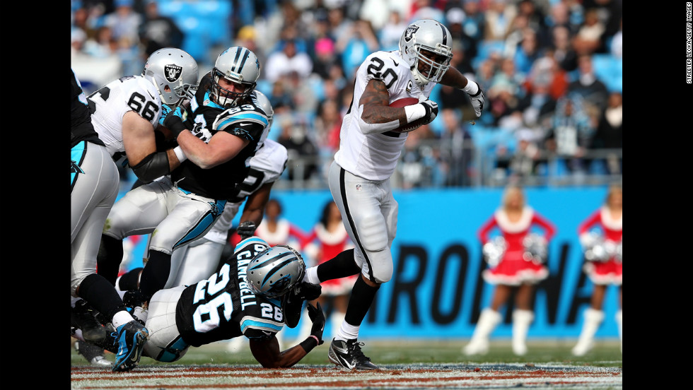 D.J. Campbell of the Panthers tries to tackle Darren McFadden of the Raiders on Sunday.