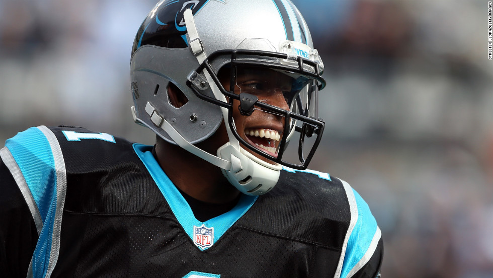 Cam Newton of the Panthers reacts after throwing a touchdown pass to teammate Steve Smith against the Raiders on Sunday.