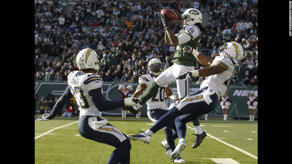 Clyde Gates of the Jets elevates over Brandon Taylor of the Chargers to make a catch on Sunday.