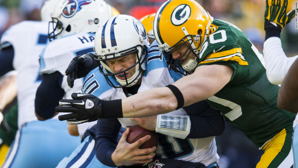 A.J.Hawk of the Green Bay Packers sacks Jake Locker of the Tennessee Titans at Lambeau Field on Sunday in Green Bay, Wisconsin, on Sunday.