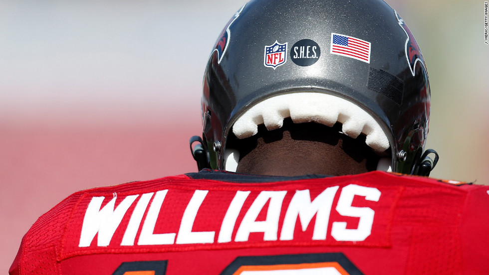 Players for the Tampa Bay Buccaneers wear a Sandy Hook Elementary School decal on their helmets during the game against the St. Louis Rams at Raymond James Stadium on Sunday in Tampa, Florida.