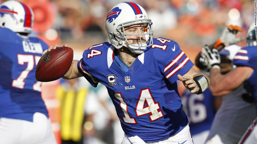 Ryan Fitzpatrick of the Bills runs with the ball out of the pocket against the Dolphins on Sunday.