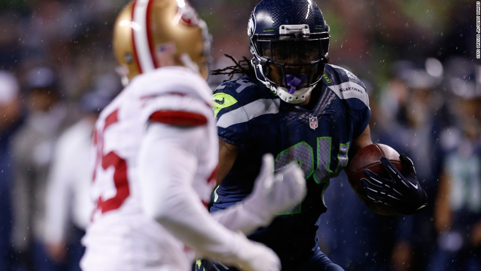 Marshawn Lynch of the Seattle Seahawks runs the ball in the first half against the San Francisco 49ers on Sunday.