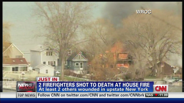 2 firefighters shot dead at house fire