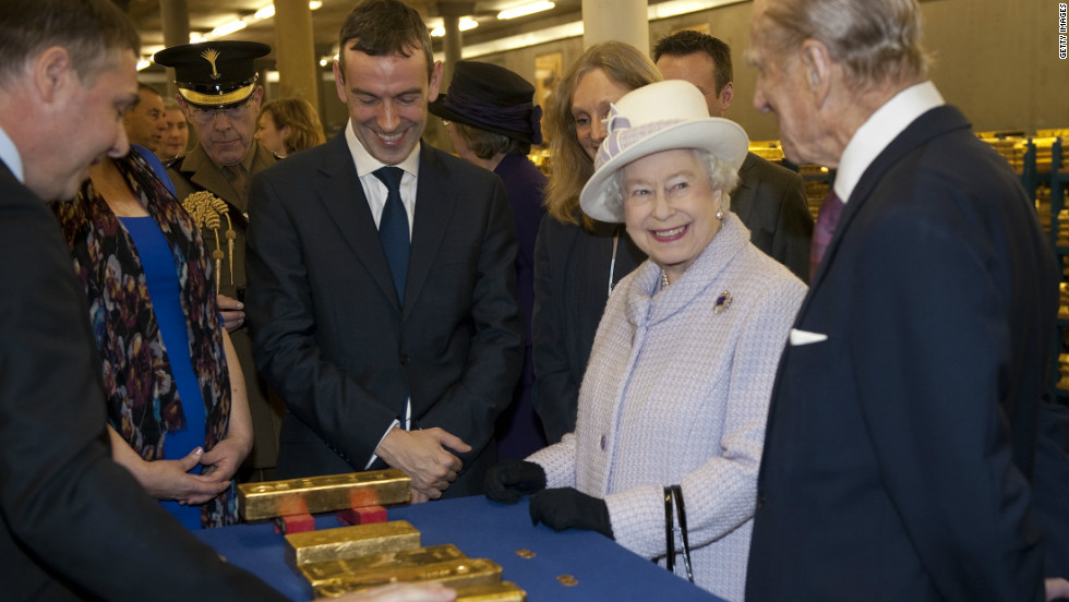 Queen Elizabeth II views stacks of gold as she visits the Bank of England with Prince Philip, Duke of Edinburgh, on December 13, 2012 in London, England.