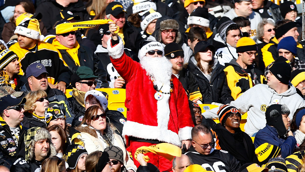 A Steelers fan in a Santa outfit waves his Terrible Towel during the game between the Pittsburgh Steelers and Cincinnati Bengals on Sunday, December 23, in Pittsburgh.