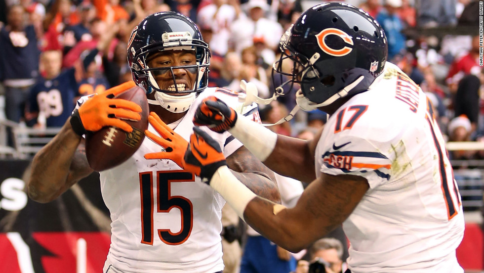 Wide receiver Brandon Marshall of the Bears celebrates with wide receiver Alshon Jeffery after a 11-yard touchdown reception against the Cardinals during the second quarter on Sunday.