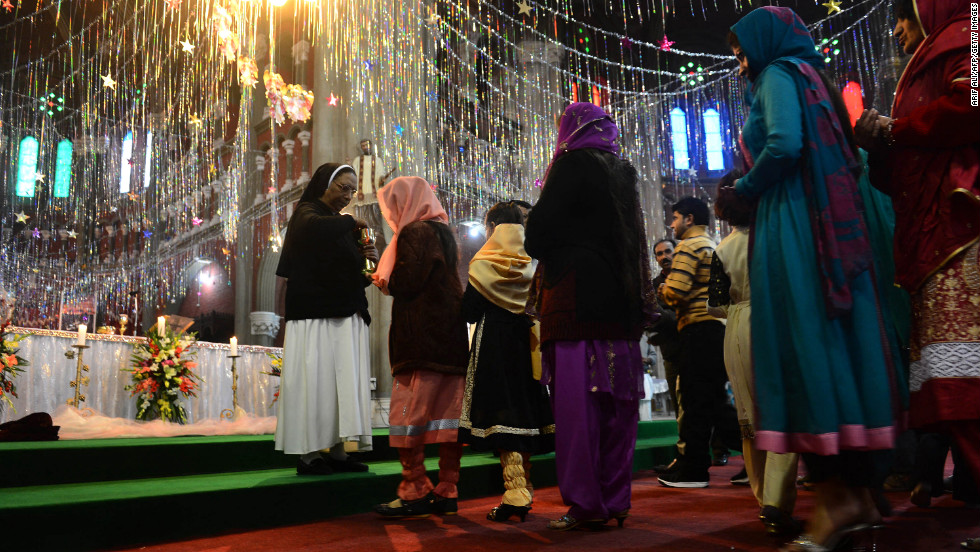 Christians take communion during a Christmas Mass at Saint Anthony's Church in Lahore, Pakistan.