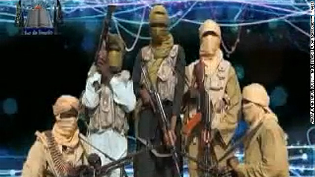 An image released by the radical Islamist group Ansaru reportedly shows  members posing at an undisclosed place in 2012.