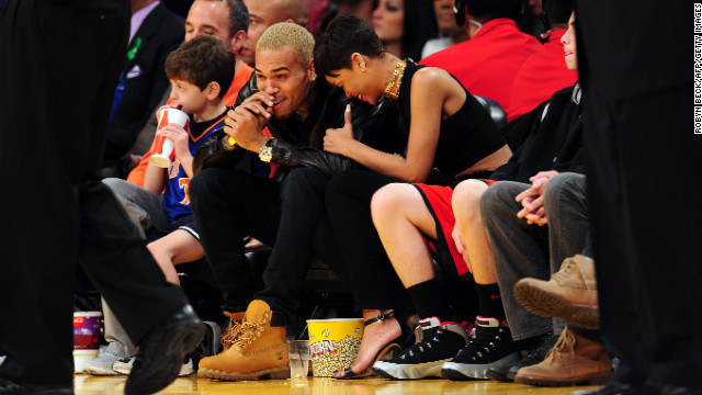 Rihanna and Chris Brown attended an NBA game in Los Angeles, California, on Christmas Day 2012.