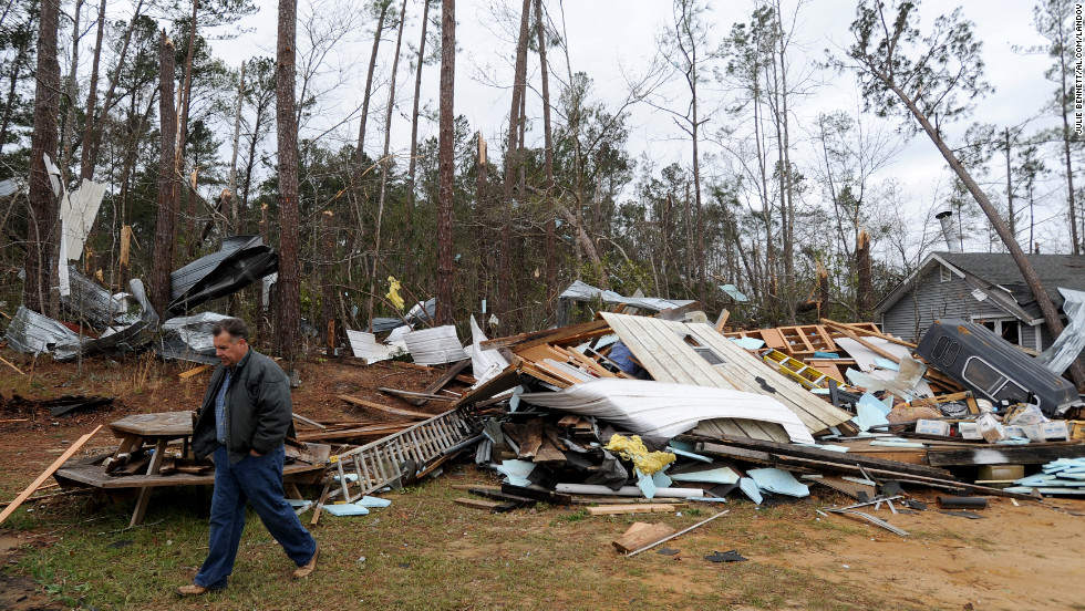 Home owner Mike Nichols surveys damage caused by a tornado that hit his home near Troy, Alabama, on December 26.