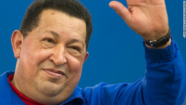 Venezuelan President Hugo Chavez waves to supporters during a campaign rally in Yaritagua, Yaracui state, on October 2, 2012.