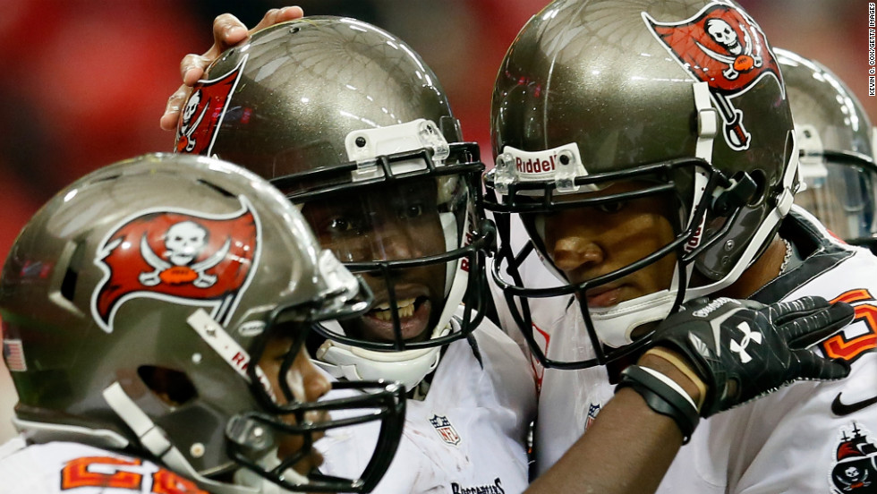 Mike Williams, center, of the Tampa Bay Buccaneers celebrates his touchdown with Doug Martin, left, and Josh Freeman at the Georgia Dome.