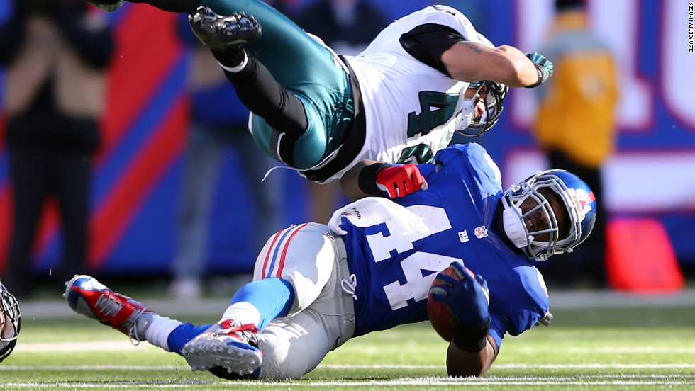 Ahmad Bradshaw of the New York Giants is tackled by Kurt Coleman of the Philadelphia Eagles on Sunday.
