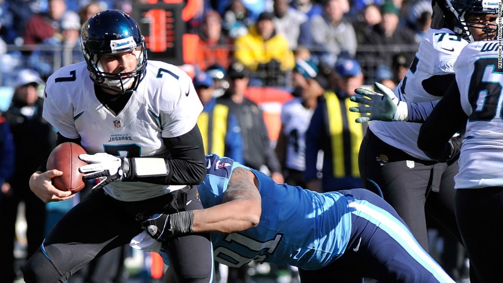 Quarterback Chad Henne of the Jacksonville Jaguars is sacked by Derrick Morgan of the Tennessee Titans on Sunday.
