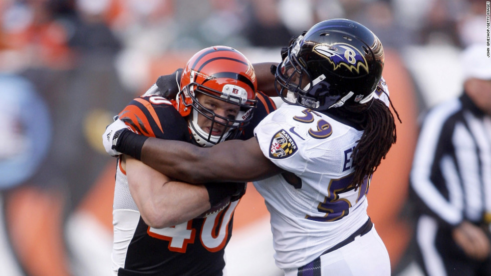 Dannell Ellerbe of the Baltimore Ravens tackles Brian Leonard of the Cincinnati Bengals on Sunday.