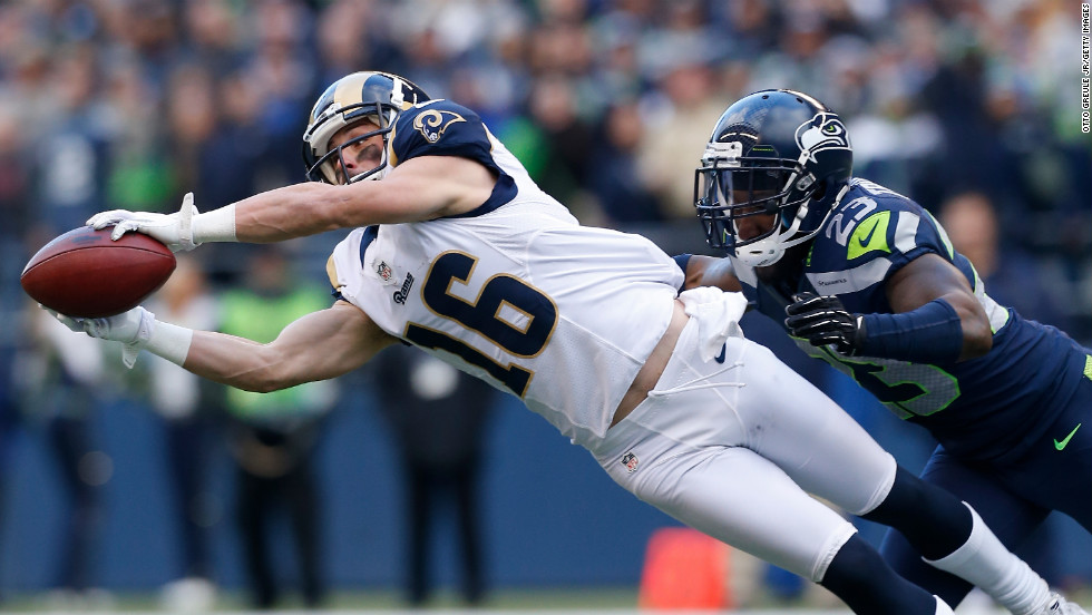 Wide receiver Danny Amendola of the St. Louis Rams makes a diving catch against cornerback Marcus Trufant of the Seattle Seahawks on Sunday.