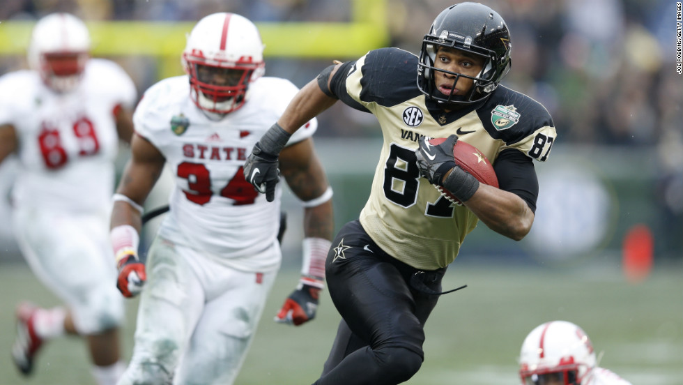 Jordan Matthews of the Vanderbilt Commodores heads toward the end zone for an 18-yard touchdown catch and run against the North Carolina State Wolfpack on December 31.