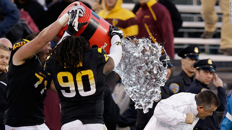 Arizona State head coach Todd Graham is doused by his players after they beat the Navy Midshipmen in the Kraft Fight Hunger Bowl on December 29.