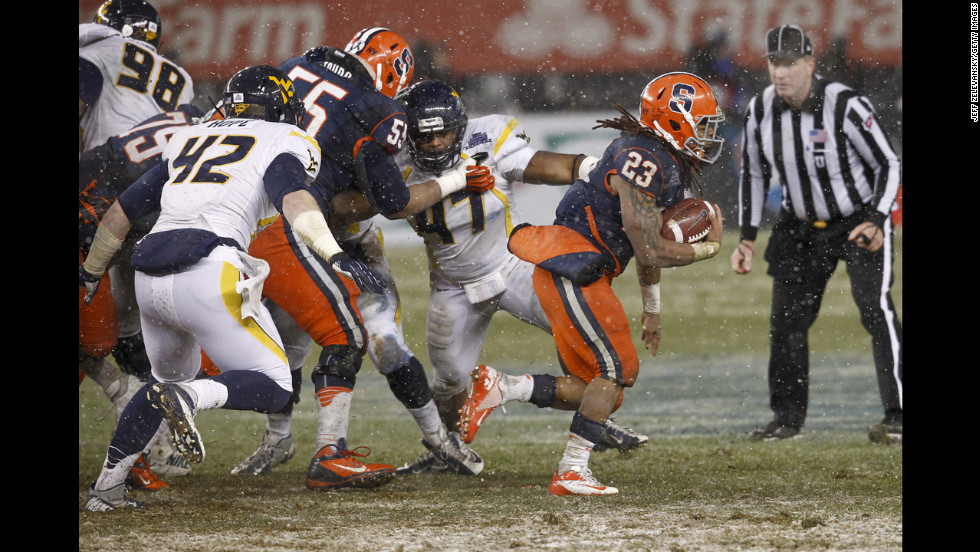 Prince-Tyson Gulley of the Syracuse Orange runs for a touchdown against the West Virginia Mountaineers in the New Era Pinstripe Bowl.
