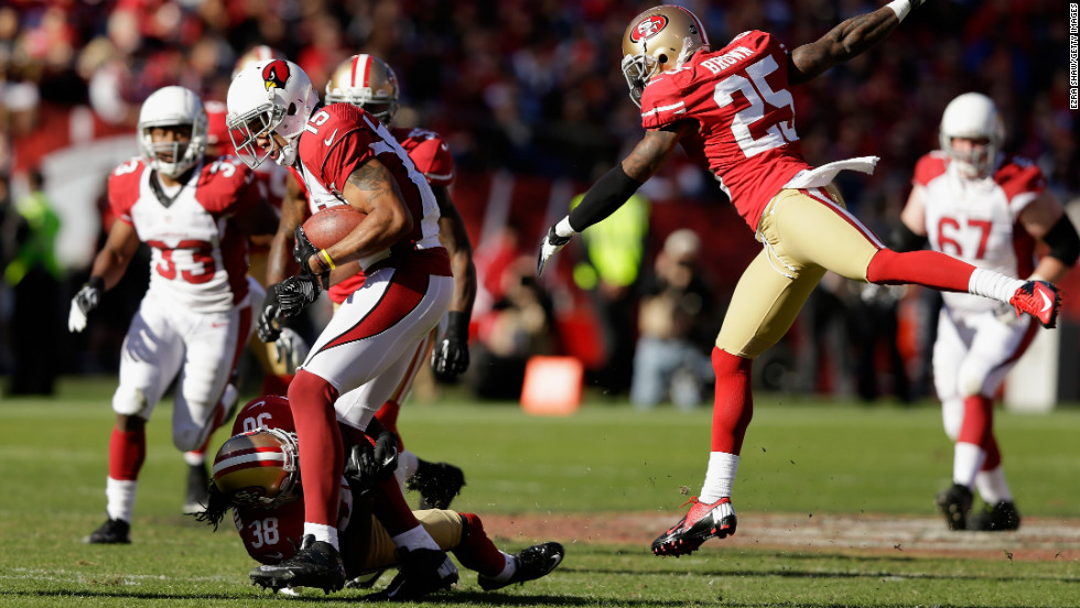 Michael Floyd of the Arizona Cardinals is tackled by Dashon Goldson of the San Francisco 49ers while Tarell Brown of the San Francisco 49ers jumps in to assist at Candlestick Park on Sunday in San Francisco.
