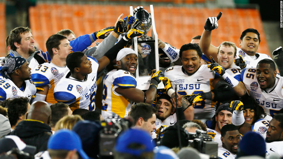 Members of the San Jose State Spartans hold up the trophy after defeating the Bowling Green Falcons 29-20 to win the Military Bowl.
