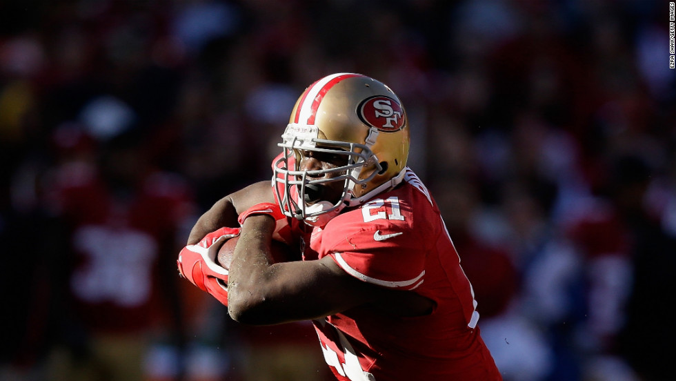 Frank Gore of the San Francisco 49ers runs with the ball on Sunday.