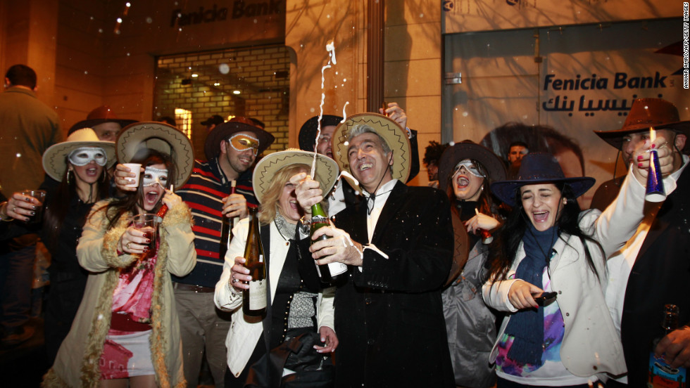 Partiers in Beirut, Lebanon, celebrate the new year early Tuesday.