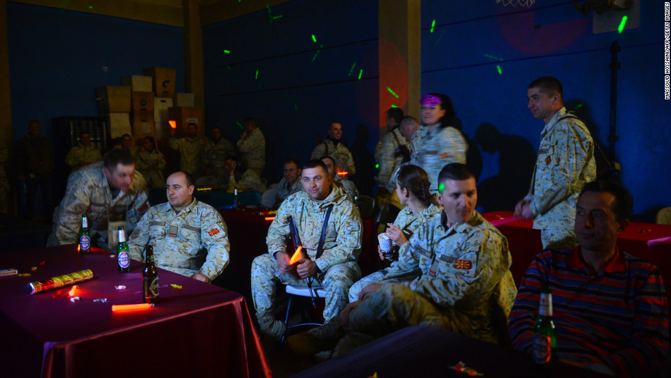 NATO troops from the International Security Assistance Force look on during celebrations on New Year's Eve right before the start of 2013 in Kabul, Afghanistan.