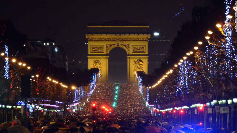 People gather on Champs-Elysees Avenue in Paris to mark the beginning of 2013.
