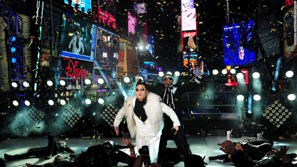 South Korean singer Psy performs with rapper MC Hammer during New Year's Eve celebrations in Times Square in New York.