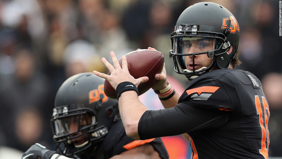 Clint Chelf of the Oklahoma State Cowboys passes against the Purdue Boilermakers on January 1 in Dallas.