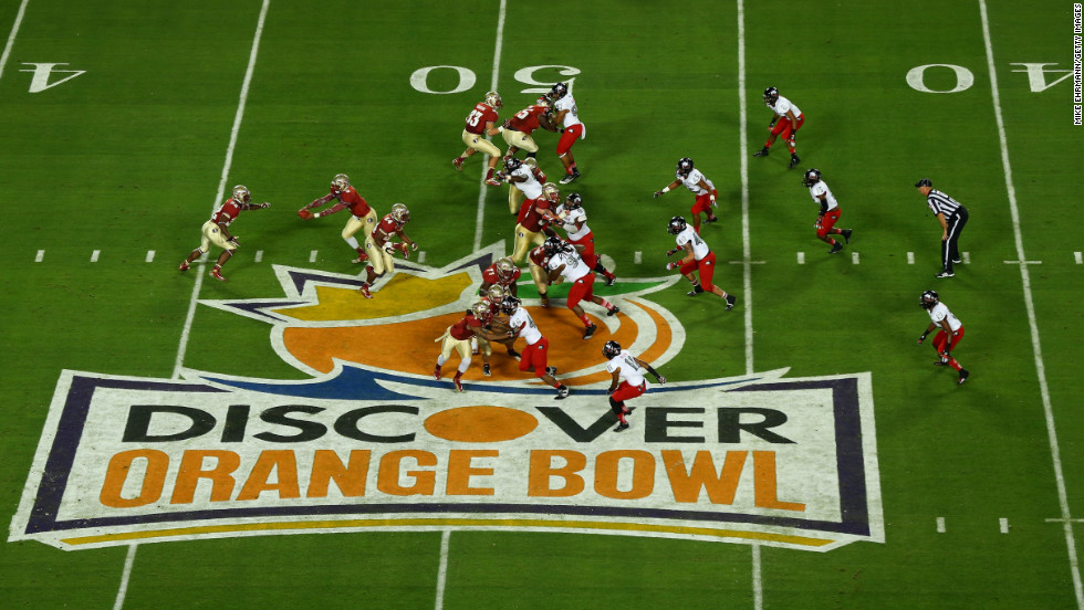 Quarterback EJ Manuel of the Florida State Seminoles makes a hand-off in the first quarter against the Northern Illinois Huskies during the Discover Orange Bowl at Sun Life Stadium on Tuesday, January 1, in Miami Gardens, Florida.