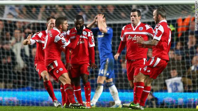 QPR players celebrate following Shaun Wright-Phillips' 78th minute winner at Chelsea.