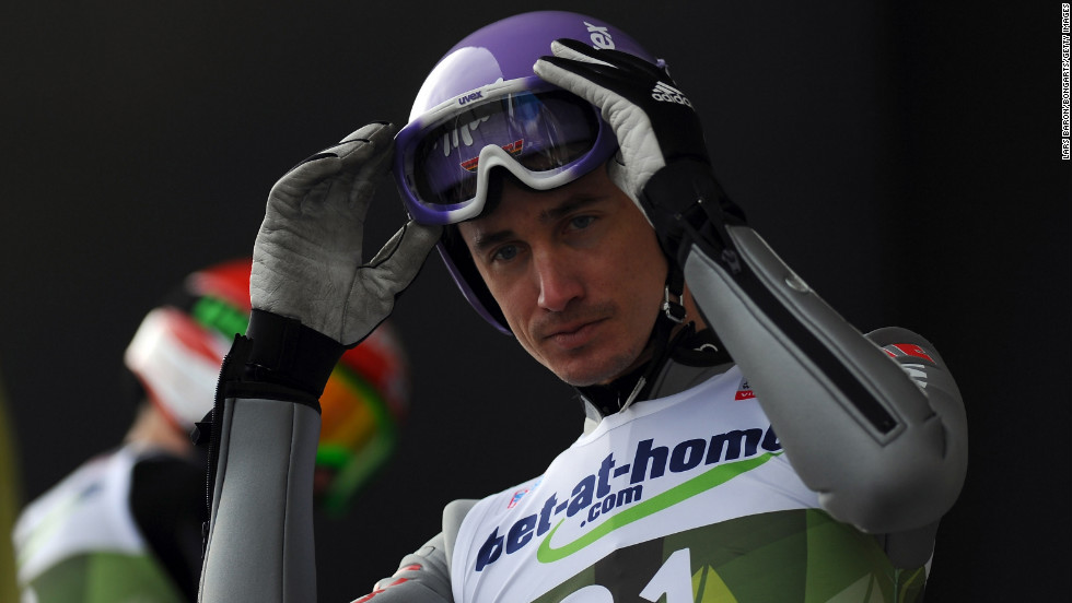 Martin Schmitt of Germany gets set for a jump during the training round on January 3.