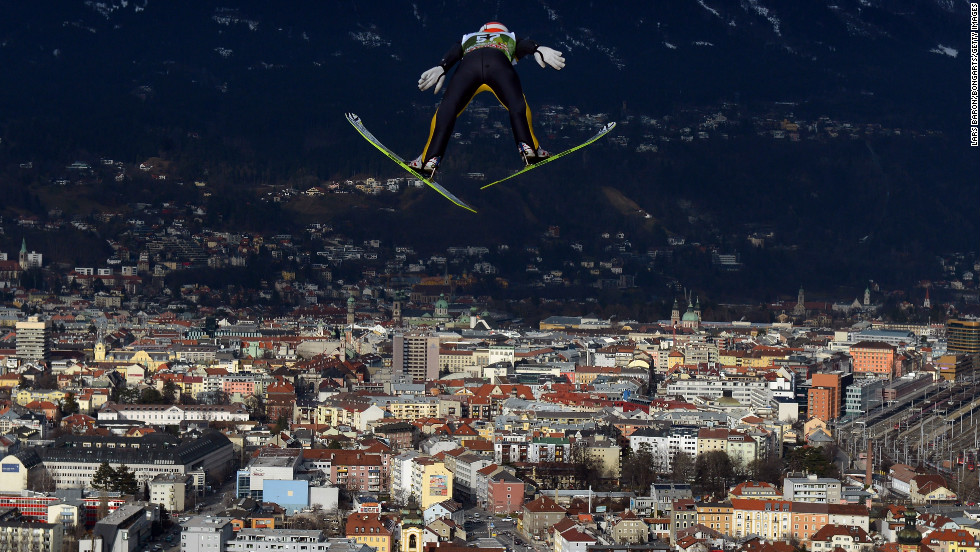 Richard Freitag of Germany soars over the skyline of Innsbruck, Austria, during the training round on Thursday, January 3.